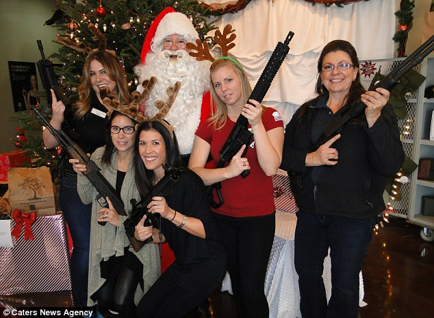 Excited: Staff running the event couldn't resist getting their own reindeer-themed armory shot