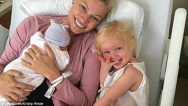 Mother daughter time: Kristy after giving birth to second daughter, Harper, pictured with her first-born, Dylan