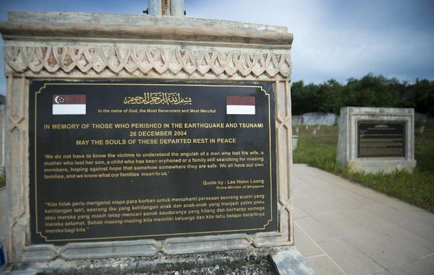 A memorial monument at a mass grave for the victims of the December 26, 2004 tsunami, pictured on November 30, 2014 in Meulaboh, Aceh province