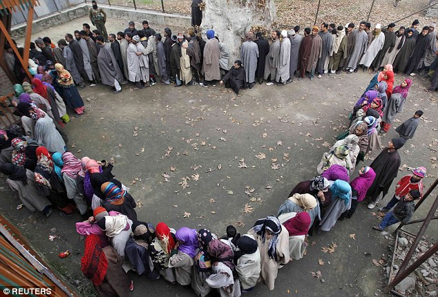 Kashmiri men and women are split into separate queues as they wait to cast their votes at a polling station on the outskirts of Srinagar