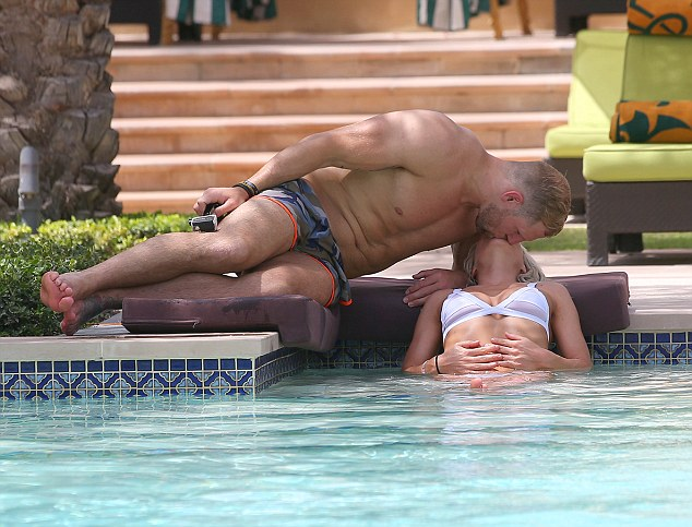 Romantic getaway: They were clearly besotted, lying out in the sun and kissing