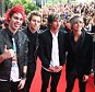 SYDNEY, AUSTRALIA - NOVEMBER 26:  5 Seconds of Summer (L-R) Michael Clifford, Luke Hemmings, Calum Hood and Ashton Irwin arrives at the 28th Annual ARIA Awards 2014 at the Star on November 26, 2014 in Sydney, Australia.  (Photo by Ryan Pierse/Getty Images)