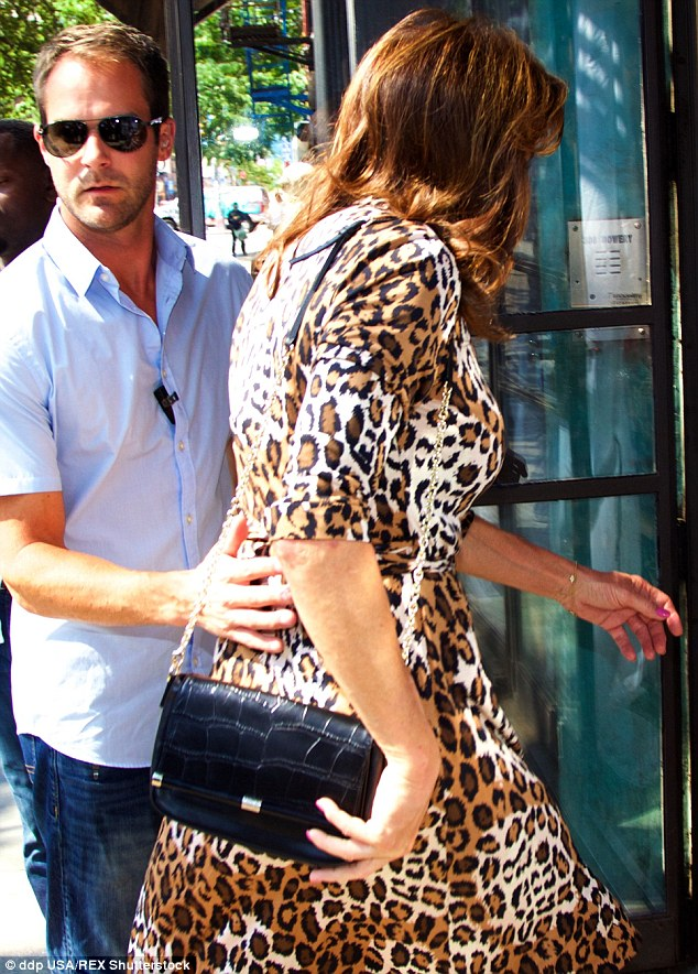 Style secrets: Caitlyn also seemed to have taken some fashion tips from her Kardashian daughters on another outing wearing a leopard print wrap dress while in the Big Apple