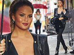 Chrissy Teigen spotted looking biker chic in a leather jacket and matching snakeskin bag while departing her residence in NYC\n\nPictured: Chrissy Teigen\nRef: SPL1121275  100915  \nPicture by: J. Webber / Splash News\n\nSplash News and Pictures\nLos Angeles: 310-821-2666\nNew York: 212-619-2666\nLondon: 870-934-2666\nphotodesk@splashnews.com\n