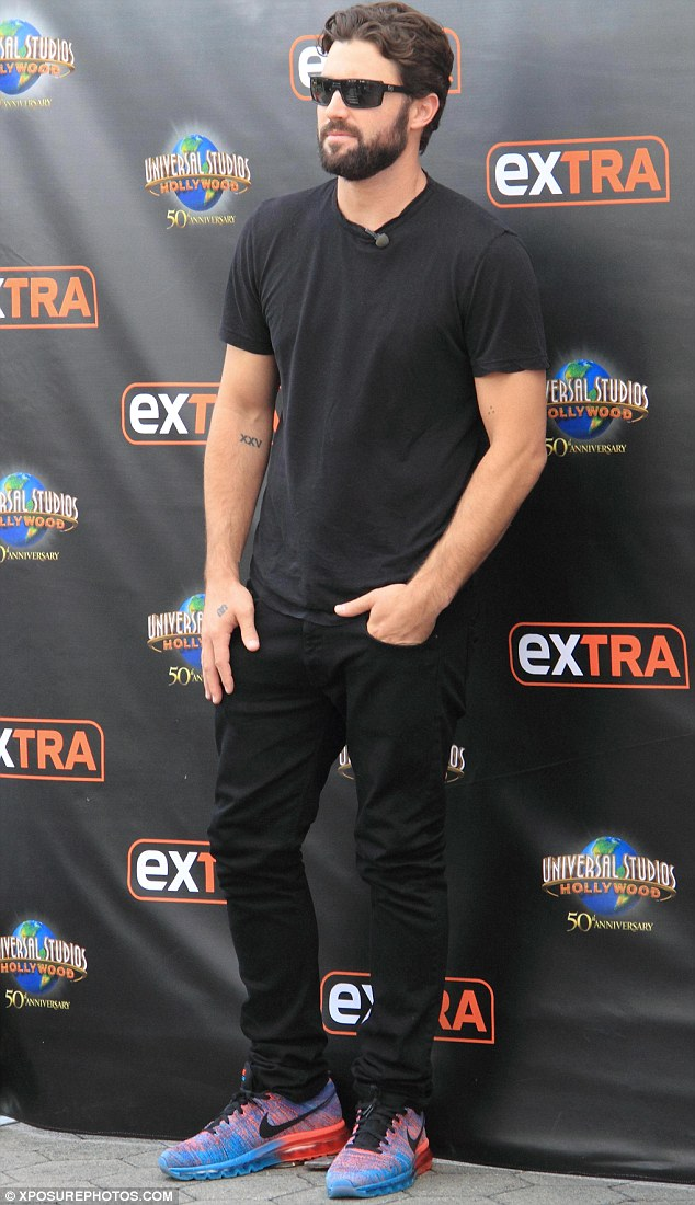 Meanwhile: Brody Jenner was relishing the chance to make an on-camera appearance on Extra in LA