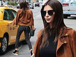 Emily Ratajkowski grab the taxi in Soho New York September 11, 2015\n\nPictured: Emily Ratajkowski\nRef: SPL1123082  110915  \nPicture by: Splash News\n\nSplash News and Pictures\nLos Angeles: 310-821-2666\nNew York: 212-619-2666\nLondon: 870-934-2666\nphotodesk@splashnews.com\n