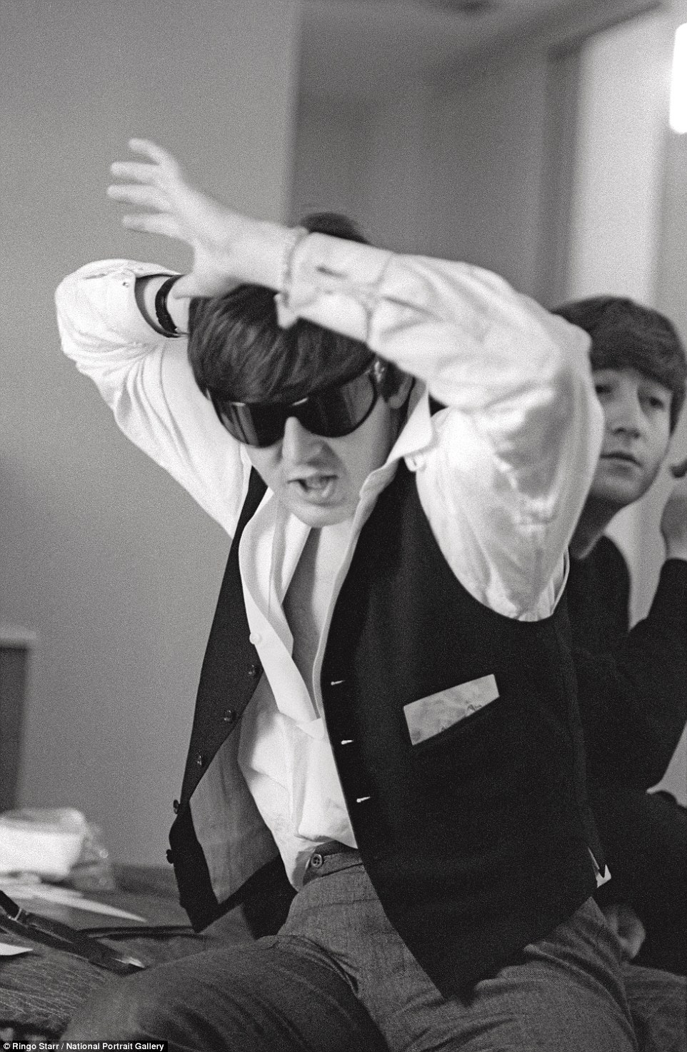 Dancing around: Paul McCartney does a jig on a hotel bed in a photo taken in New York in February 1964