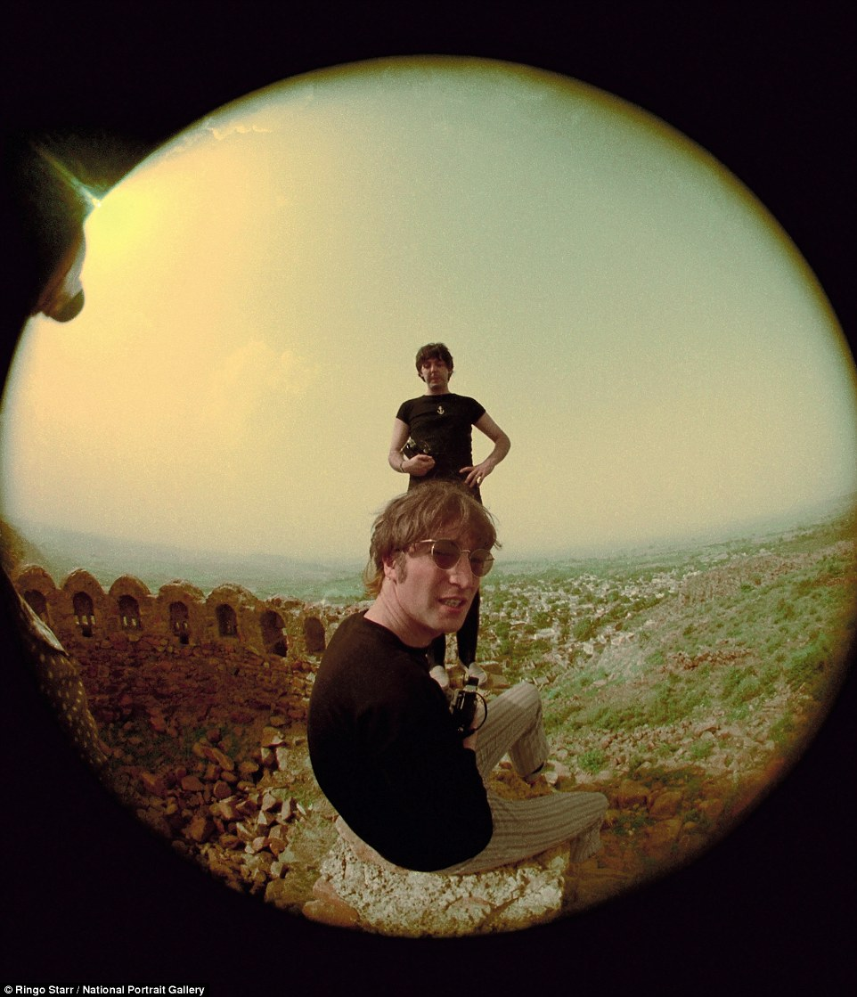 On tour: McCartney and Lennon photographed relaxing near Delhi on a tour of India in July 1966