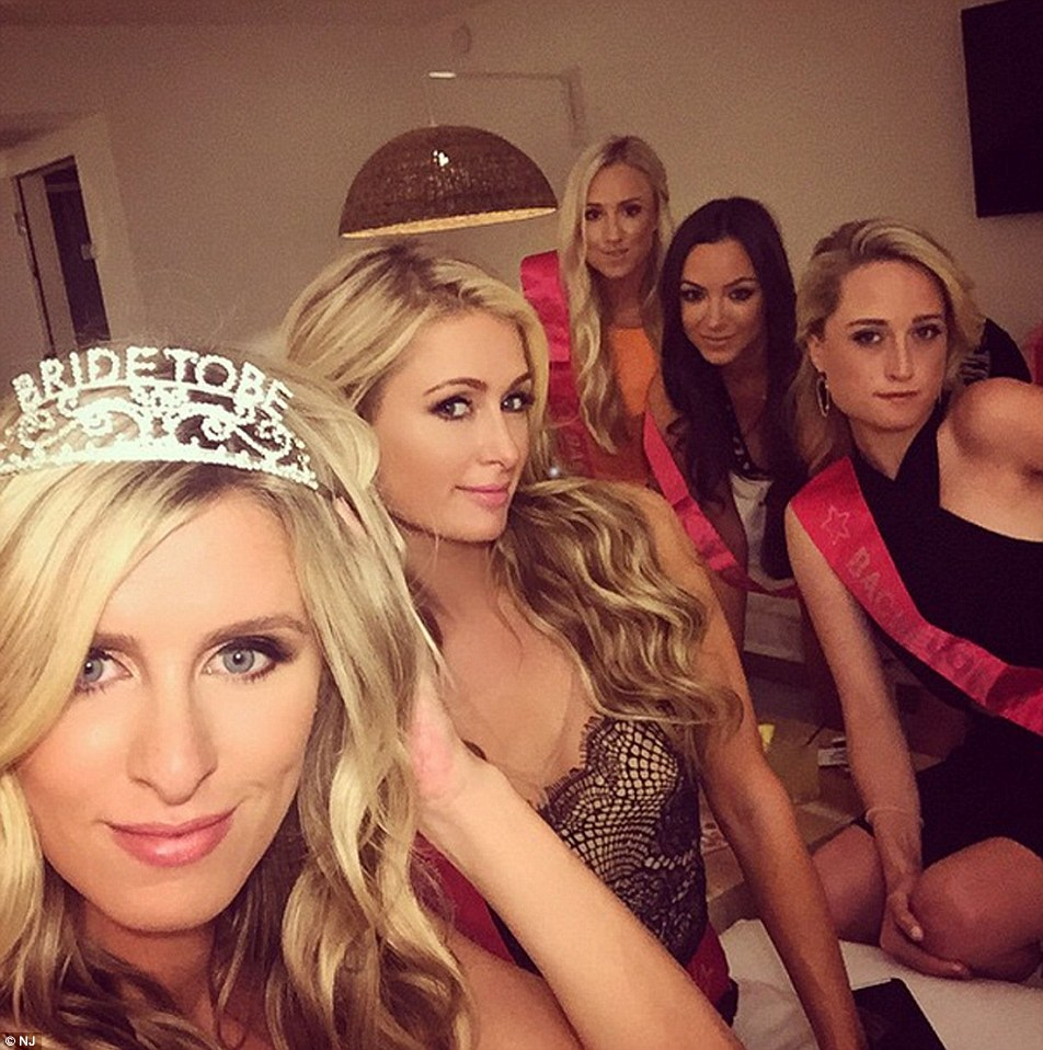 Nicky's second hen-do  where she is pictured wearing the bride-to-be tiara while her friends and sister are dressed in sashes
