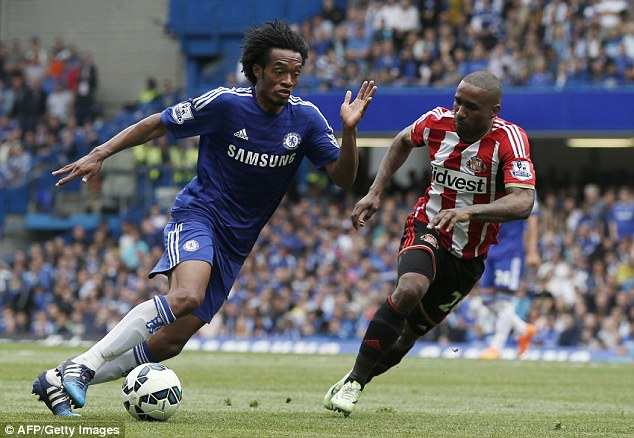 Cuadrado (left) is determined to stay at Chelsea and prove his worth to the first-team, his agent claims