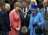 Britain's Queen Elizabeth speaks with Scotland's First Minister Nicola Sturgeon after arriving with Prince Philip (R) at Edinburgh Waverley Station, before boarding a train drawn by a steam locomotive to travel along the Scottish Borders Railway in Scotland, Britain September 9, 2015. Queen Elizabeth who ascended the throne aged just 25 as her exhausted country struggled to recover from the ravages of World War Two, made history on Wednesday when she become Britain's longest-reigning monarch. REUTERS/Russell Cheyne