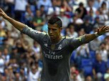 Real Madrid's Portuguese forward Cristiano Ronaldo celebrates after scoring a goal during the Spanish league football match RCD Espanyol vs Real Madrid CF at?the Power8 stadium in Cornella de Llobregat on September 12, 2015.   AFP PHOTO/ LLUIS GENELLUIS GENE/AFP/Getty Images