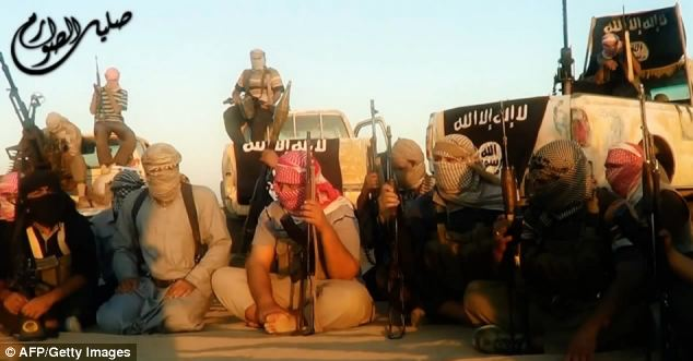 ISIS fighters, one group pictured, preach an extreme form of Islam and want to create an Islamic utopia. Khawaja is accused of attending a training camp with associated group Rayat Al Taweed