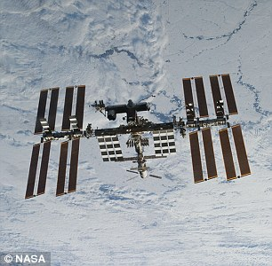 The spacecraft was scheduled to dock with the International Space Station six hours after take off, but that plan has now been 'indefinitely abandoned'. Pictured a cargo ship in the same family,Progress M-59, as seen from the International Space Station (right) during docking