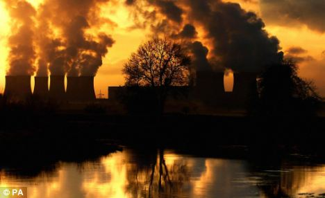Climate change cost: Emissions rising from Drax Power Station near Selby, Yorkshire. Enviromentalists blame the flooding and extremes of weather Britain is facing on global warming caused by pollution