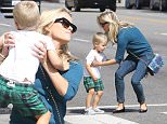 Reese Witherspoon taking a stroll through Brentwood with her cutie pie son Tennessee Toth. September 11, 2015 X17online.com