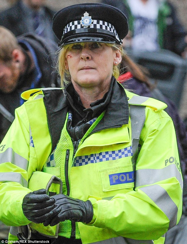 On the front line:Sarah Lancashire on the Happy Valley set playing bloodied sergeant Catherine Cawood