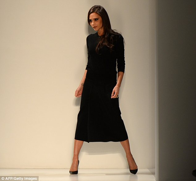 Take a bow: Mrs Beckham steps out from backstage at the end of her New York Fashion Week show