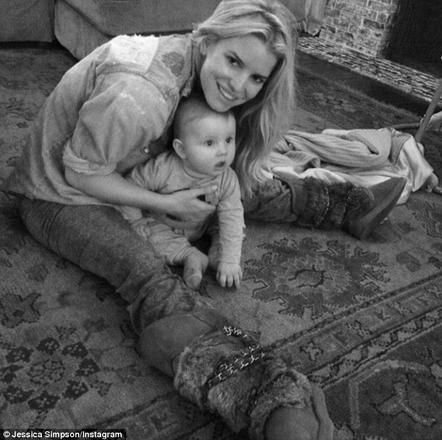 Relaxing at home: The doting mother-of-two frequently posts b&w family snaps on Instagram of her cherubic eight-month-old son Ace