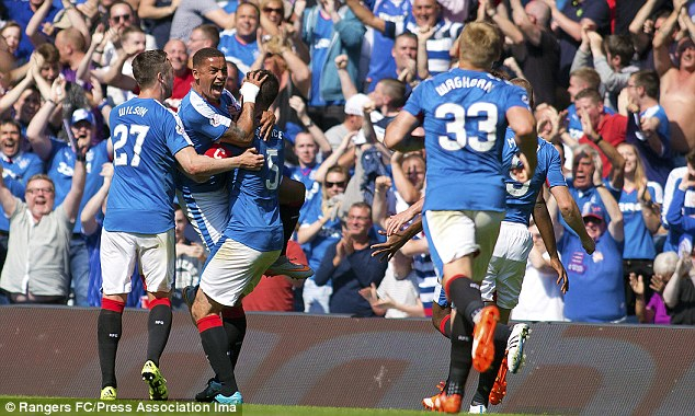 James Tavernier roars in celebration having fired in a free-kick which ended up as the winning goal