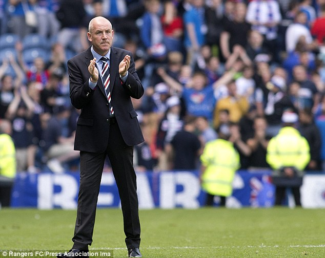 Rangers manager Mark Warburton applauds the home crowd at Ibrox following the narrow victory