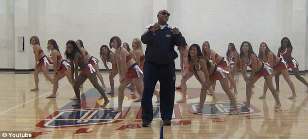 Gangnam Style: A sports teacher at University of Illinois Chicago poses as South Korean star Psy while the university cheerleaders imitate the original dance in their own parody of the hit