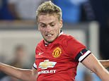 SAN JOSE, CA - JULY 21:  James Wilson of Manchester United in action with Paulo Renato of San Jose Earthquakes during the International Champions Cup 2015 match between San Jose Earthquakes and Manchester United at Avaya Stadium on July 21, 2015 in San Jose, California.  (Photo by Tom Purslow/Man Utd via Getty Images)