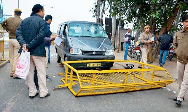 The incident occurred when the policemen at the Kalindi Kunj barricade asked the driver to stop his car