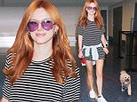 11.SEPT.2015 - LOS ANGELES - USA\n*STRICTLY AVAILABLE FOR UK AND GERMANY USE ONLY*\nACTRESS BELLA THORNE ARRIVES AT LAX AIRPORT TO CATCH A FRIDAY NIGHT FLIGHT OUT OF LOS ANGELES WITH HER POOCH. THE BEAUTIFUL ACTRESS ROCKED A STRIPED SHIRT DRESS AND WHITE SNEAKERS AS SHE WALKED HER DOG ON A LEASH INTO THE AIRPORT\nBYLINE MUST READ : XPOSUREPHOTOS.COM\n***UK CLIENTS - PICTURES CONTAINING CHILDREN PLEASE PIXELATE FACE PRIOR TO PUBLICATION ***\n*UK CLIENTS MUST CALL PRIOR TO TV OR ONLINE USAGE PLEASE TELEPHONE 0208 344 2007*