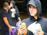EXCLUSIVE: Justin Bieber spotted bitting a huge sandwich from subway while out and about in New York City\n\nPictured: Justin Bieber\nRef: SPL1121044  090915   EXCLUSIVE\nPicture by: Felipe Ramales / Splash News\n\nSplash News and Pictures\nLos Angeles: 310-821-2666\nNew York: 212-619-2666\nLondon: 870-934-2666\nphotodesk@splashnews.com\n