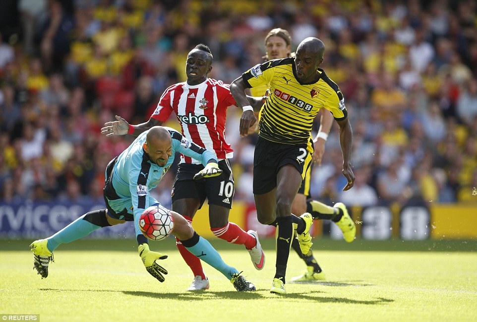 Southampton forward Mane (2nd left) was involved in an early clash with Watford's Heurelho Gomes and Allan Nyom (right)