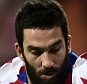 FILE PHOTO: Atletico Madrid midfielder Arda Turan wants a move to the Premier League this summer and has three offers from top English clubs, according to his agent. Real Madrid's Cristiano Ronaldo (right) and Atletico Madrid's Arda Turan battle for the ball ... Soccer - UEFA Champions League - Quarter Final - Second Leg - Real Madrid v Atletico Madrid - Santiago Bernabeu ... 22-04-2015 ... Madrid ... Spain ... Photo credit should read: Adam Davy/EMPICS Sport. Unique Reference No. 22806444 ...
