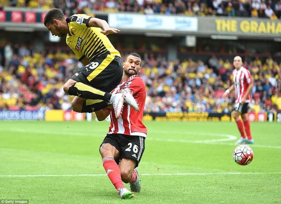 Southampton defender Steven Caulker (centre) makes a timely intervention to take the ball away from Watford's Capoue