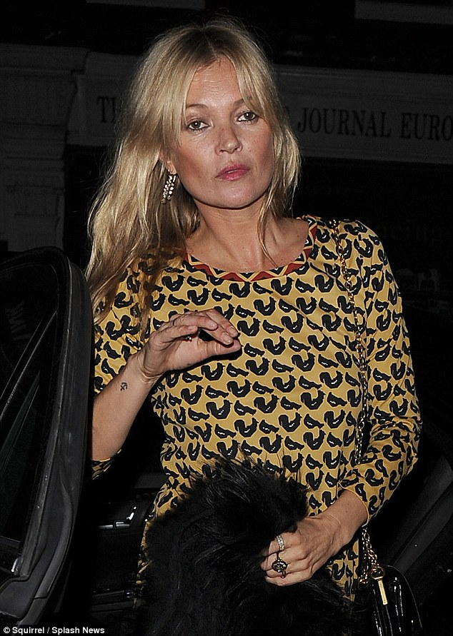 Good night Kate? Kate Moss was seen losing her balance slightly as she enjoyed another night out in Mayfair on Friday