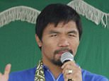 This photo taken on September 10, 2015 shows Philippine boxing icon Manny Pacquiao delivering a speech during the inauguration of a low-cost housing village owned and named after him in Glan town, Sarangani province, on the southern island of Mindanao. Pacquiao declared he was vindicated over previous drugs allegations from Floyd Mayweather after his American rival was accused of violating anti-doping rules before their mega-fight. AFP PHOTO / Aquiles ZonioAQUILES ZONIO/AFP/Getty Images