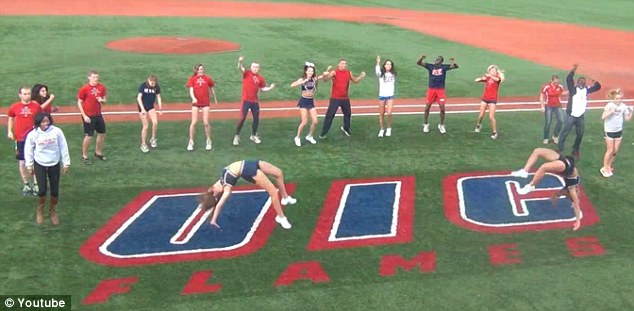 Yeah! Students on the baseball field do the now famous riding dance move