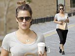 11.SEPT.2015 - LONDON - UK ** EXCLUSIVE ALL ROUND PICTURES ** TV PRESENTER CAROLINE FLACK SEEN ENJOYING A COFFEE WHILE RUNNING ERRANDS IN NORTH LONDON. THE XTRA FACTOR HOST IS PICTURED IN A CASUAL OUTFIT ON HER DAY OFF BYLINE MUST READ : XPOSUREPHOTOS.COM ***UK CLIENTS - PICTURES CONTAINING CHILDREN PLEASE PIXELATE FACE PRIOR TO PUBLICATION*** UK CLIENTS MUST CALL PRIOR TO TV OR ONLINE USAGE PLEASE TELEPHONE 0208 344 2007