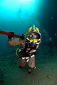 US Navy 080726-N-3093M-011 avy Diver 1st Class Johnelisha Andrews walks across the seabed with a pipe wrench.jpg
