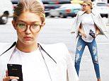 September 11, 2015: Gigi Hadid seen in white shirt and blazer and distressed denim in New York City.\nMandatory Credit: Alberto Reyes/INFphoto.com Ref.: infusny-261