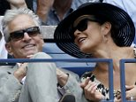 Actor Michael Douglas and his wife, actress Catherine Zeta Jones, attend the women's singles finals match between Roberta Vinci of Italy and compatriot Flavia Pennetta at the U.S. Open Championships tennis tournament in New York, September 12, 2015.   REUTERS/Mike Segar