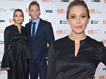 """TORONTO, ON - SEPTEMBER 11:  Actors Elizabeth Olsen and Tom Hiddleston attends the """"I Saw the Light"""" premiere during the 2015 Toronto International Film Festival at Ryerson Theatre on September 11, 2015 in Toronto, Canada.  (Photo by Alberto E. Rodriguez/Getty Images)"""