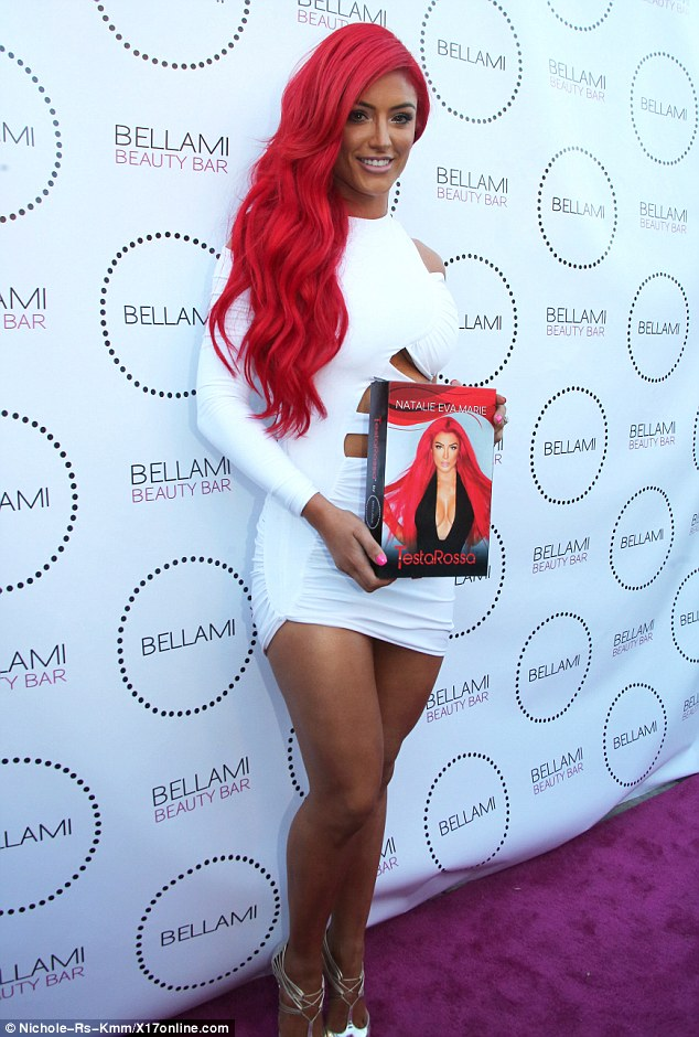 She's got competition! Eva Marie of Total Divas rocked VERY fiery locks during the event