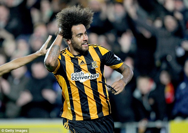 On target: Hull's Tom Huddlestone celebrates after scoring against Fulham in the 6-0 victory