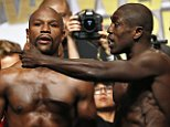 Floyd Mayweather Jr., left, and Andre Berto speak as they pose for photographers during weigh-ins Friday, Sept. 11, 2015, in Las Vegas. The two are scheduled to fight in a welterweight title bout Saturday in Las Vegas. (AP Photo/John Locher)