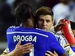 Former English Premier League stars from Liverpool and Chelsea, Steven Gerrard and Didier Drogba, now of the LA Galaxy and Montreal Impact, respectively, greet one another at the end of their MLS match on September 12, 2015 in Carson, California which ended 0-0. AFP PHOTO /FREDERIC J.BROWNFREDERIC J. BROWN/AFP/Getty Images