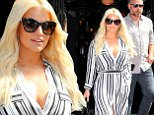 Jessica Simpson wears jail stripes inspired outfit when departing her hotel with Eric Johnson in NYC\n\nPictured: Jessica Simpson, ERic Johnson\nRef: SPL1123102  110915  \nPicture by: XactpiX/sPLash\n\nSplash News and Pictures\nLos Angeles: 310-821-2666\nNew York: 212-619-2666\nLondon: 870-934-2666\nphotodesk@splashnews.com\n