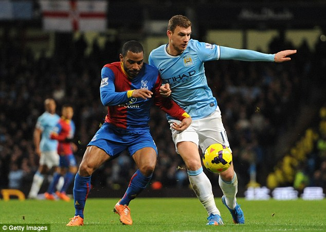 On the fringes: But Edin Dzeko returned to Manchester City's line-up for the game against Crystal Palace