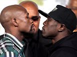 Floyd Mayweather Jr. (L) faces off with Andre Berto (R) during a press conference  on September 9, 2015 at the MGM Grand in Las Vegas. Mayweather will defend his WBC/WBA welterweight titles against Andre Berto on September 12 at the MGM Grand.   AFP PHOTO/JOHN GURZINSKIJOHN GURZINSKI/AFP/Getty Images