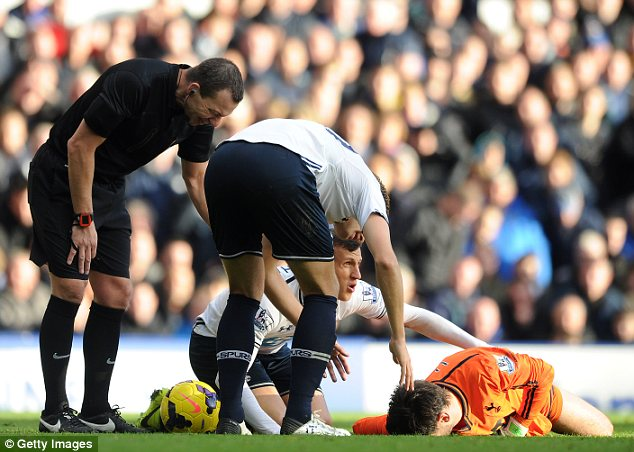 Concern: Spurs goalkeeper Hugo Lloris was allowed to carry on playing against Everton this season, despite suffering a head injury