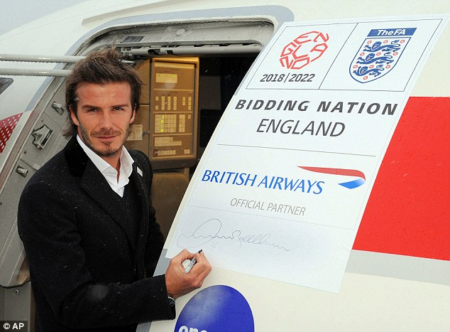 Sign us up! David Beckham sticks his autograph on the plane before departing for Zurich